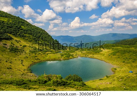 Lake in the Carpathian Mountains in autumn. Ukraine - stock photo