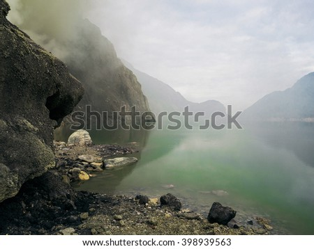 Lake in the crater of Ijen volcano, Indonesia - stock photo