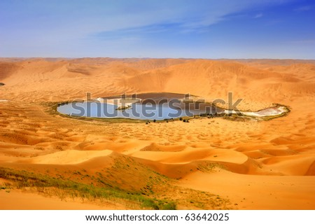 Lake in the gansu desert - stock photo
