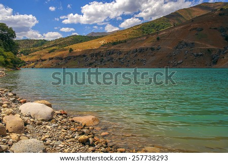 Lake in Tien-Shan mountains - stock photo