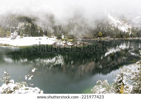 Lake in winter in the Swiss alps in Wallis. - stock photo