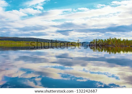 Lake Inari , the King of Lapland Lakes in calm autumn day (Finland). - stock photo
