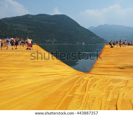 LAKE ISEO, ITALY - CIRCA JUNE 2016: The Floating Piers site specific landscape artwork by Christo and Jeanne Claude - stock photo