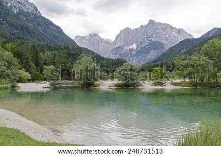 Lake Jasna in Kranjska Gora. Lake is located in the middle of Slovenian Alps  - stock photo