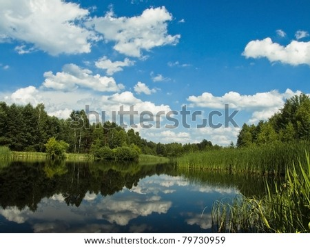 Lake landscape with blue sky - stock photo