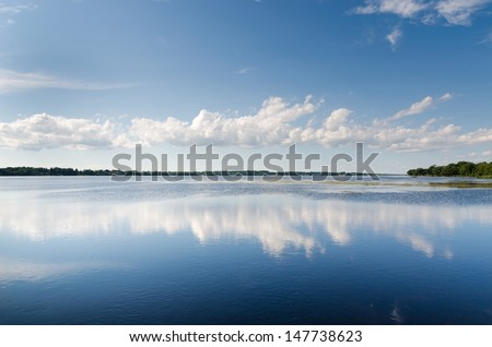 lake landscape with cloud reflections - stock photo