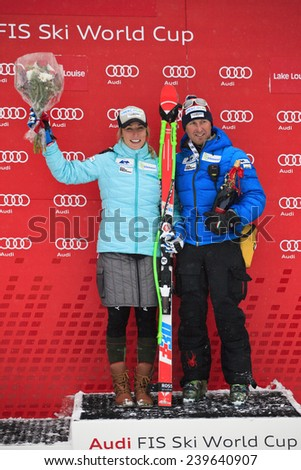 LAKE LOUISE ALBERTA CANADA  6 DECEMBER  2014    : Marie-Michele Gagnon and her coach   after competing   women's Audi FIS Alpine Skiing World Cup giant slalom race.  - stock photo