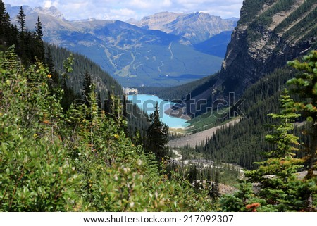 Lake Louise and the Chateau Lake Louise seen from the Plain of the Six Glaciers hiking trail, Banff National Park, Alberta, Canada - stock photo