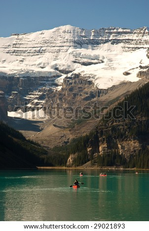 Lake louise with canoes - stock photo