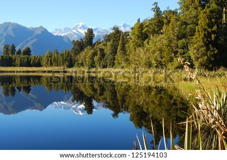 Lake Matheson in New Zealand - stock photo
