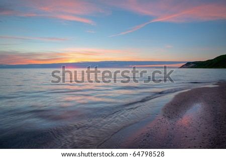 Lake Michigan shoreline at sunset, Sleeping Bear Dunes National Lakeshore, Michigan, USA - stock photo