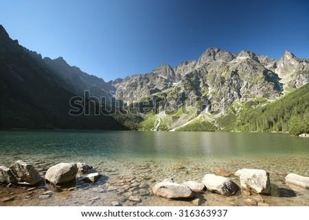 """Lake """"Morskie Oko"""" in the Tatra National Park. - stock photo"""
