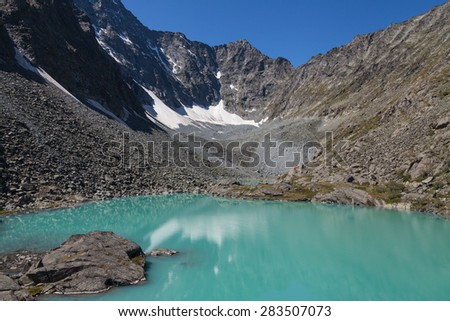 Lake, mountains, rocks - stock photo