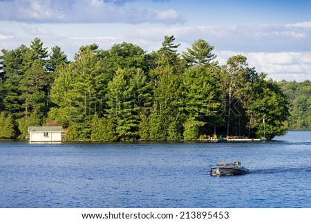 Lake MUSKOKA, ONTARIO - AUGUST 24, 2014: Lake Muskoka and Muskoka Township is one of the most popular recreational regions in Ontario, located just two hours north of Toronto - stock photo