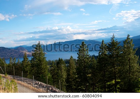 Lake Okanagan set among mountains and forests in British Columbia Canada - stock photo