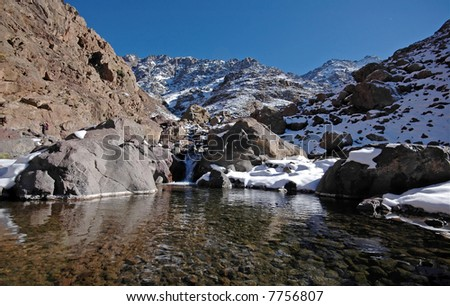 Lake on the way to the mt Toubkal. Highest mountain in the North Africa. Morocco. High-Atlas. - stock photo