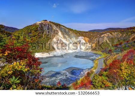 Lake Oyunuma in Noboribetsu, Hokkaido, Japan. THe water is sulfurous with surface temperatures reaching 50 degrees celsius. - stock photo
