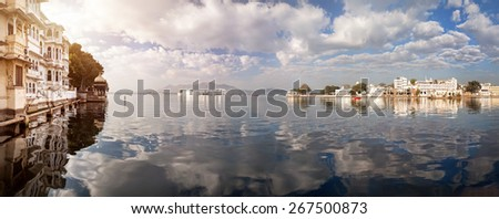 Lake Pichola Panorama with white palace in the center at cloudy sky in Udaipur, Rajasthan, India - stock photo