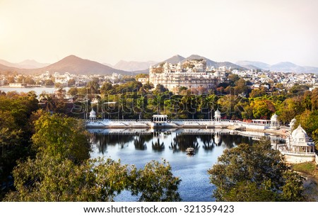 Lake Pichola with City Palace view in Udaipur, Rajasthan, India - stock photo