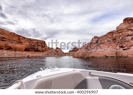 Lake Powell Arizona viewed from a speed boat navigating through the red rock canyons - stock photo