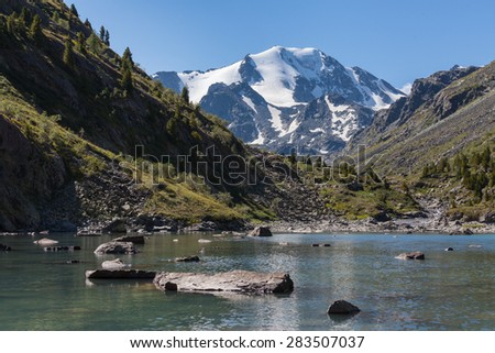 lake rocks mountain glacier - stock photo