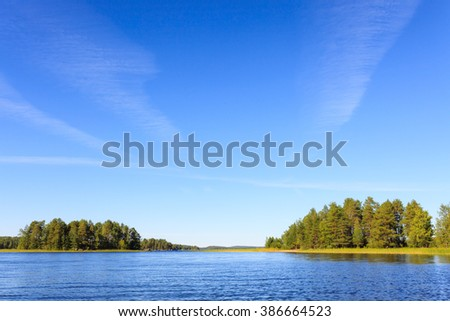 Lake scenery in Finland on a sunny day - stock photo