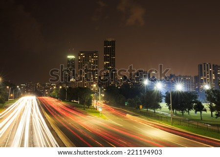 Lake Shore Drive traffic coming in and out of the city of Chicago - stock photo