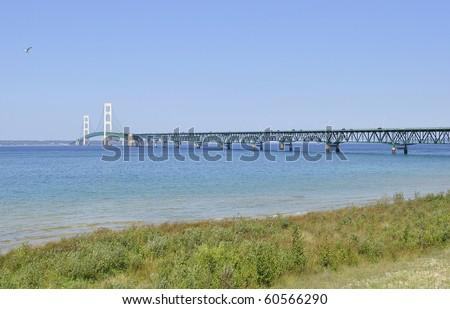 Lake shore of Mackinac and bridge - stock photo