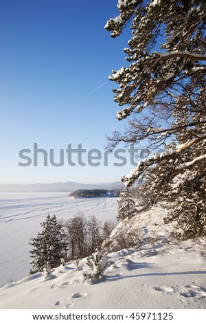 Lake shore with fir trees in winter at Urals, Russia - stock photo