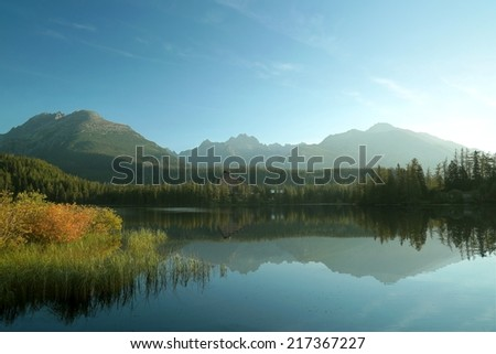Lake Strba surrounded by high Tatra mountains in Slovakia. - stock photo