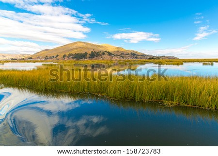 Lake Titicaca,South America, located on border of Peru and Bolivia. It sits 3,812 m above sea level, making it one of the highest commercially navigable lakes in the world. - stock photo