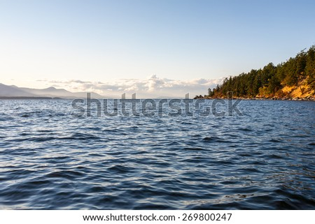 lake under blue cloudy sky - stock photo