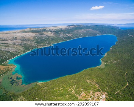 Lake Vrana on Cres Island shot from drone at 700m in altitude. A fresh water lake which is below sea level. - stock photo