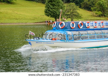 LAKE WINDERMERE, CUMBRIA, ENGLAND - OCT 18th 2014: People on a cruise ship ship Miss Cumbria at  Lake Windermere, Cumbria, England. - stock photo