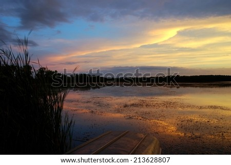 Lake Wingra Sunset Overlooking University of Wisconsin Arboretum in August - stock photo