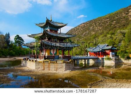 lake with bridge and pagoda, landscape in Lijiang, China - stock photo