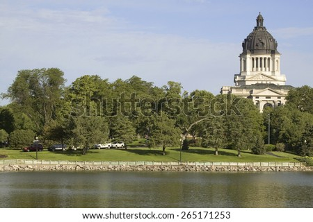 Lake with view of South Dakota State Capitol and complex, Pierre, South Dakota, built between 1905 and 1910 - stock photo