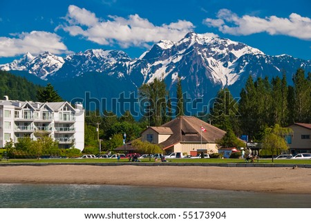 Lakeview condo over gorgeous mountains in Harrison Hot Springs, British Columbia. - stock photo