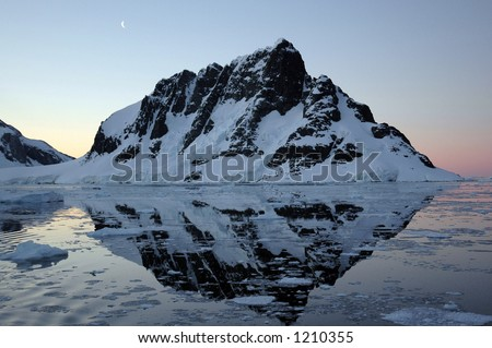 Lamaire Channel, Antarctica at sunrise - stock photo