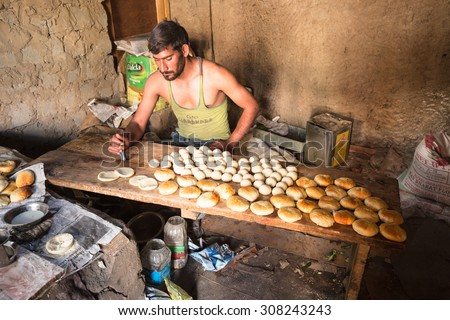 LAMAYURU, INDIA - AUGUST 9 : The young unidentified baker are working in his  bakehouse in village at Lamayuru,India on August 9,2015 - stock photo
