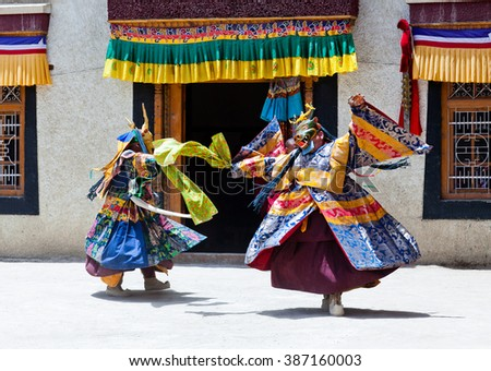 LAMAYURU, INDIA - JUNE 17, 2012: Two Buddhist monks dancing Cham dance during Yuru Kabgyat festival at Lamayuru Gompa in Ladakh, Jammu and Kashmir, North India - stock photo