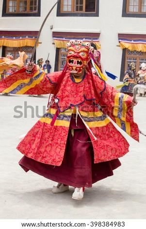 LAMAYURU, INDIA - JUNE 13, 2015: Unidentified buddhist lamas dressed in mystical mask dancing Tsam mystery dance in time of Yuru Kabgyat Buddhist festival at Lamayuru Gompa, Ladakh, North India - stock photo