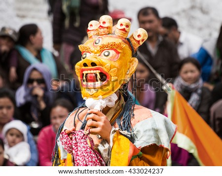 Lamayuru, India - June 17, 2012: unidentified monk performs a religious masked and costumed mystery dance of Tibetan Buddhism during the Cham Dance Festival in Lamayuru monastery, northern India. - stock photo