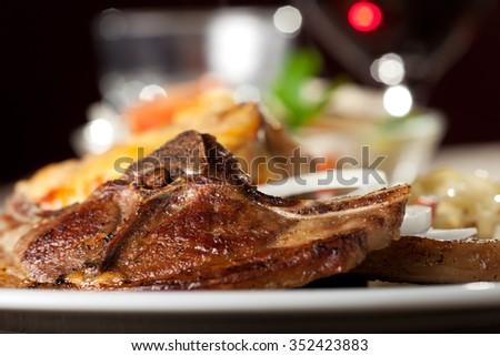 lamb chop and moussaka  - stock photo