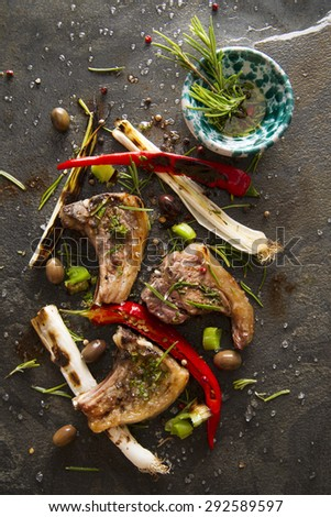 Lamb chops cooked on the grill with leek and red pepper - stock photo