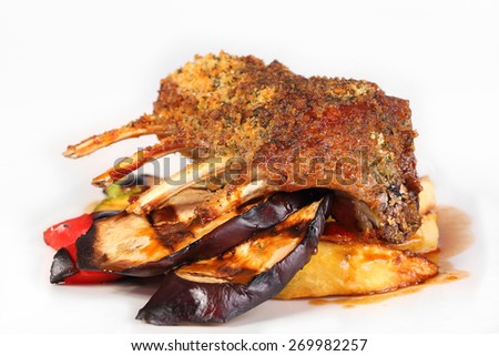 Lamb chops. Lamb with grilled vegetables. A piece of lamb on a white background. - stock photo