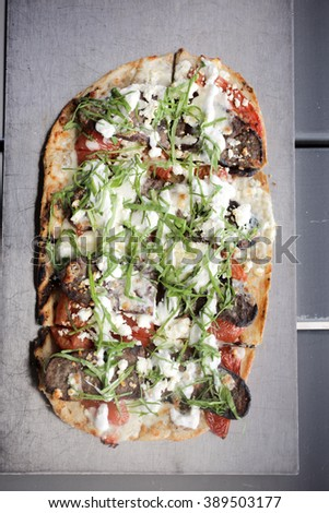 Lamb grilled flatbread with tomato, feta cheese, spinach and tzatziki sauce - stock photo