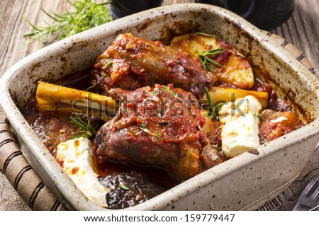 lamb knuckle with feta - stock photo