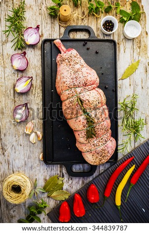 Lamb meat - leg of lamb with rosemary and spices, ready for roasting - stock photo