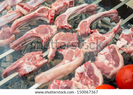 Lamb ribs barbequed on a grill - stock photo